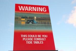 Holy Island warning sign