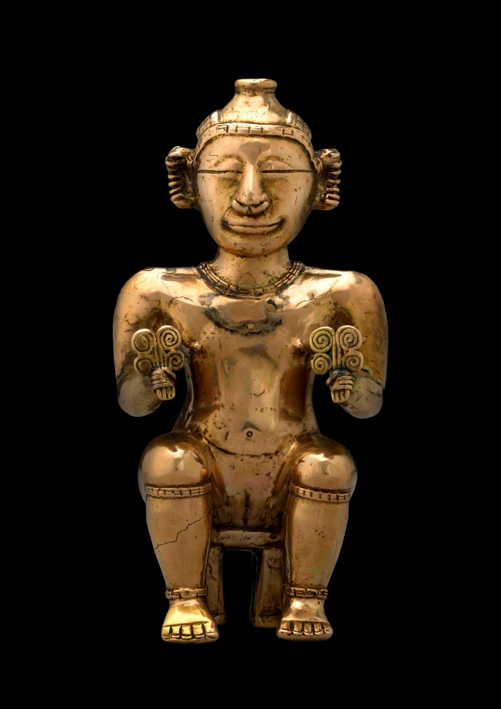 Seated female poporo, Quimbaya, gold alloy, AD600-1100. Copyright the Trustees of the British Museum