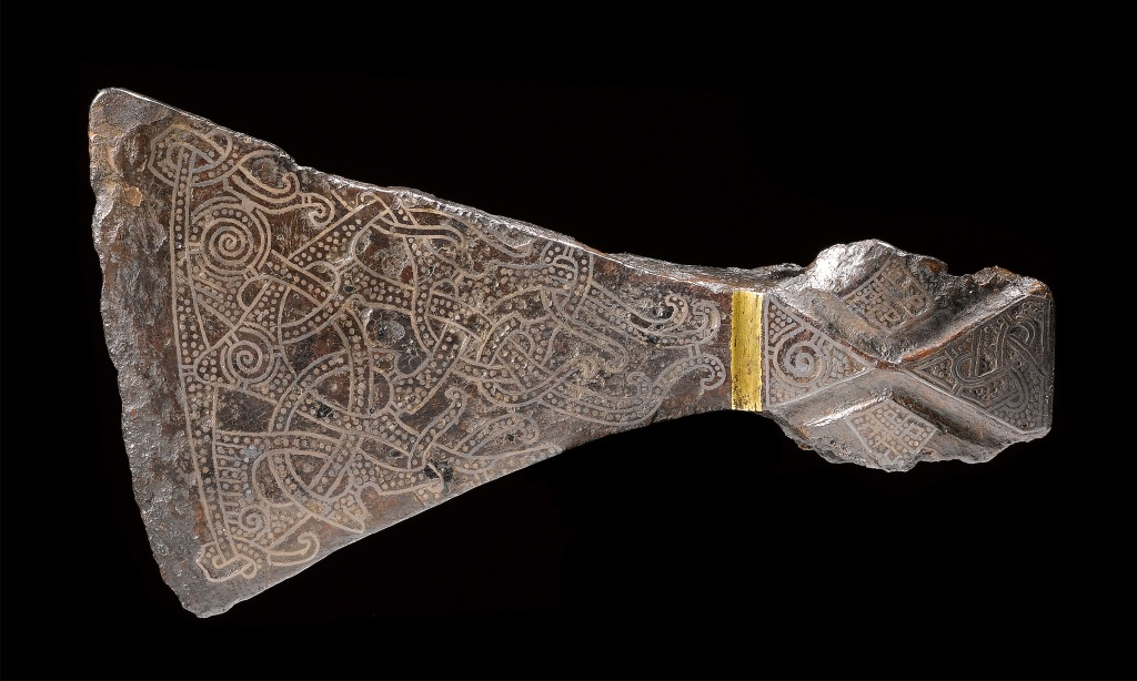 Silver-inlaid axehead in the Mammen style, AD 900s. Bjerringhoj, Mammen, Jutland, Denmark. Iron, silver, brass. L 17.5 cm. Copyright of The National Museum of Denmark