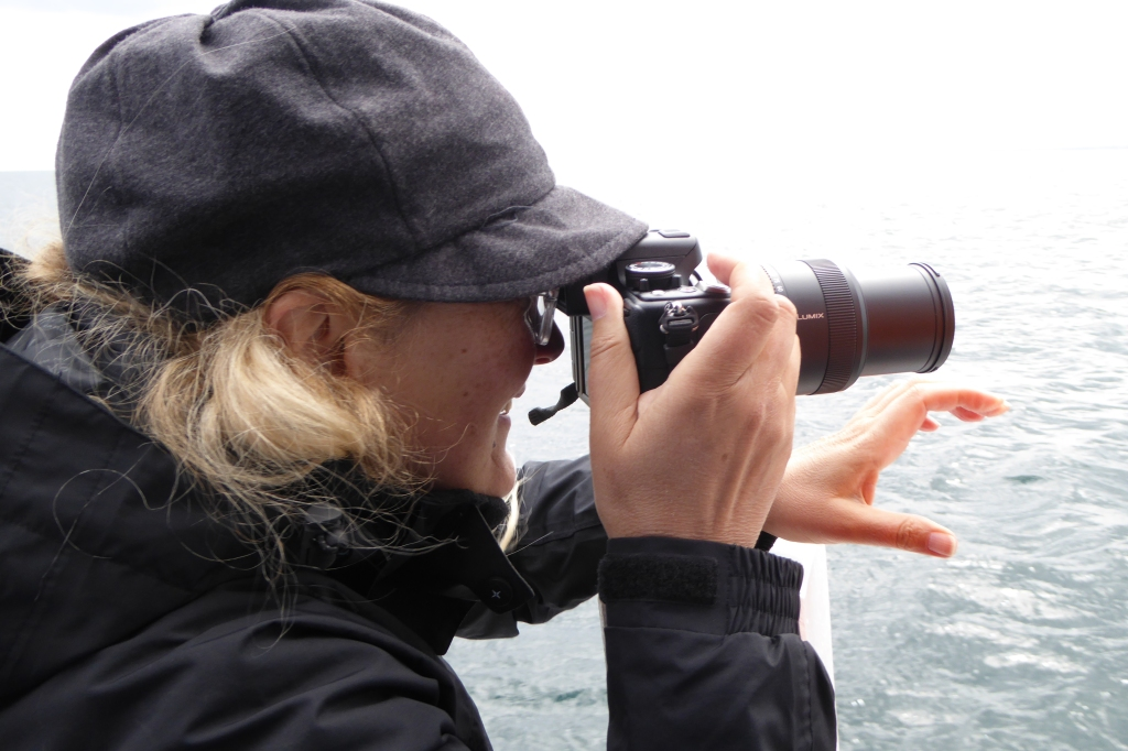 Woman with camera on Farnes