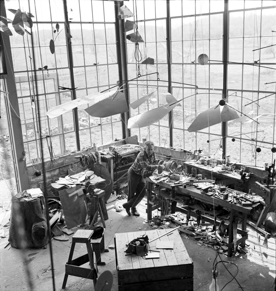 Alexander Calder in his studio